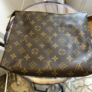 Louis Vuitton Classic Toiletry bag of Clutch
